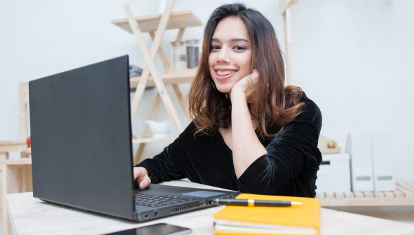 Beautiful smiling Asian student woman learning from online education service, Young Asian woman doing homework with computer laptop , notebook and smart phone